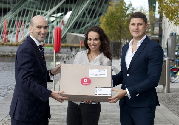 Barry Keegan, (left) Sales Director, Payzone Ireland and Danny Hughes, CEO at Parcel Connect. hand over the Parcel Connect package to online shopper Emma