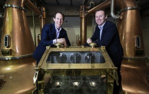 Brothers Stephen and Jack Teeling and the brass spirit safe that holds the first whiskey spirit to be produced in Dublin in almost four decades. © Patrick Bolger Photography