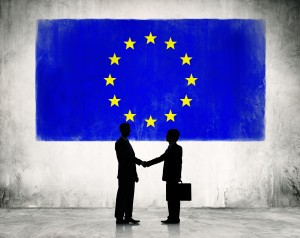 Two Business Person Shaking Hands with the European Union Flag