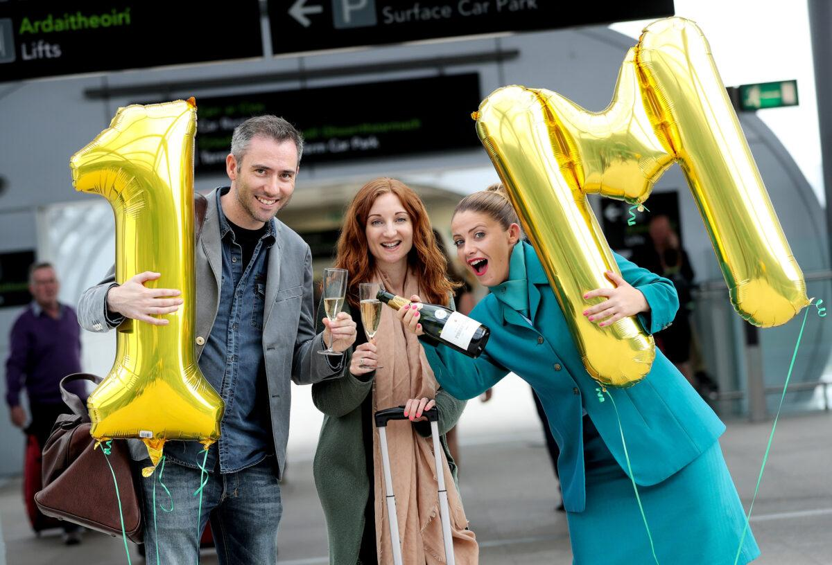 17/08/2016 NO REPRO FEE, MAXWELLS DUBLIN Aer Lingus' one millionth transatlantic passenger Ciarán Foy and Olwen Kelleghan today became Aer Lingus' one millionth transatlantic passengers. The married couple from Dublin, but currently residing in Los Angeles, were greeted by Aer Lingus crew member Sarah Jane Maples with celebratory champagne, a complimentary pair of return flights to any Aer Lingus destination and a business-class upgrade as they checked-in to their flight to Los Angeles, California in Dublin Airport's Terminal 2. Aer Lingus' new direct route from Dublin to LA launched in May as part of the airline's largest ever transatlantic expansion which also includes new direct routes to Newark, New Jersey and Hartford, Connecticut commencing this September. PIC: NO FEE, MAXWELLPHOTOGRAPHY.IE
